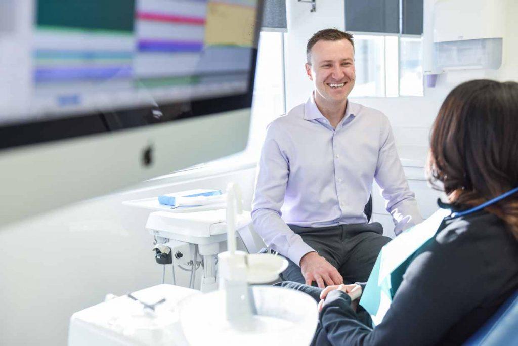 Dr. Tom Consulting Patient   West Calgary Periodontics