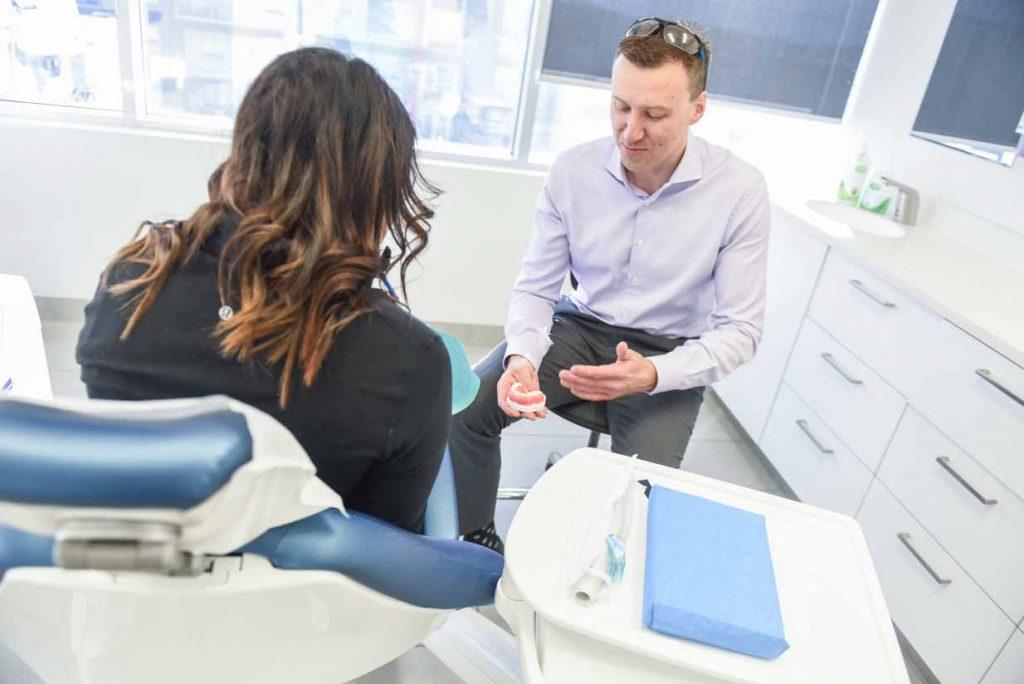 Dr. Tom Educating Patient   West Calgary Periodontics
